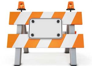 Patent infringement sign on road barricade