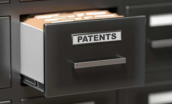 Patent files and documents in office filing cabinet
